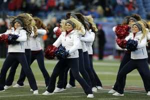 New England Patriots cheerleaders perform during the second quarter of an NFL football game against the Miami Dolphins in Foxborough, Mass., Sunday, Dec. 30, 2012