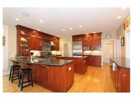 A cherry and granite kitchen.