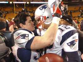 Win #08 - Tedy Bruschi hugs Tom Brady following a 41-27 victory at Heinz Field in Pittsburgh, Pennsylvania on January 23, 2005. The Patriots would advance to Super Bowl XXXIX in Jacksonville, Florida to face the Philadelphia Eagles.