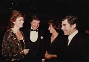 Natalie Jacobson, Chet Curtis, Kitty and Gov. Michael Dukakis.