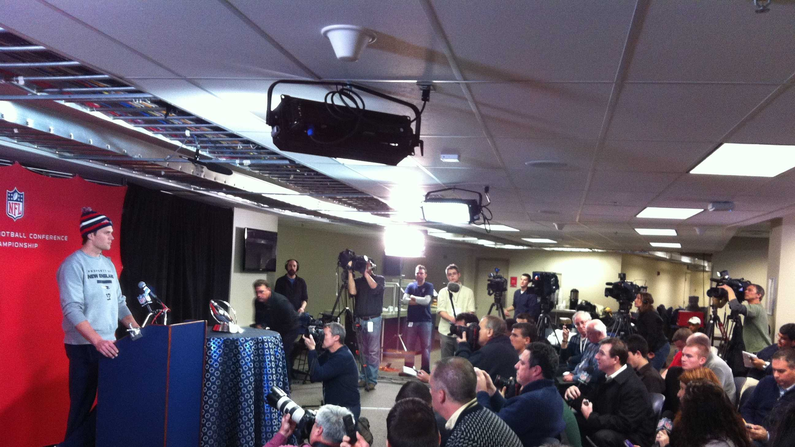 QB Tom Brady addresses a packed media room at Gillette on Wednesday.