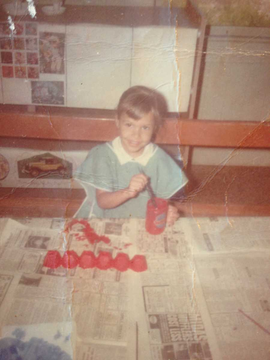 """""""I'm a 'melting pot,' but my most prominentnationality would be thanks to my mother who is from India,"""" says Liz, seen here working on a kindergarten art project."""