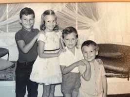 """Liz, pictured here with her three brothers, was raised in Hawaii """"but I don't have a drop ofHawaiian blood in me."""""""