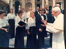 One of Liz's many passions is singing. In this picture, Liz is singing for Pope John Paul II in Rome at Vatican Square.