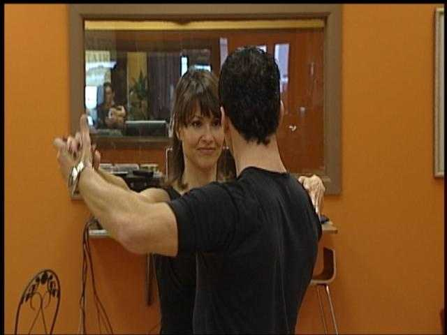 Liz's (not so) secret wish is to be on Dancing with the Stars. Here she is practicing her moves with DTWS star Tony Dovolani.