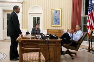 President Barack Obama meets with Rob Nabors, Assistant to the President for Legislative Affairs, and Senior Advisor Valerie Jarrett in the Oval Office, Dec. 31, 2012.