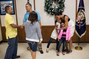 President Barack Obama and First Lady Michelle Obama greet members of the military and their families during Christmas dinner at Anderson Hall on Marine Corps Base Hawaii, Kaneohe Bay, Hawaii, Dec. 25, 2012.