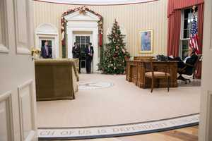 President Barack Obama talks on the phone with Rep. John Boehner, Speaker of the House, in the Oval Office, Dec. 11, 2012. Pictured, from left, are: Director of Communications Dan Pfeiffer&#x3B; Rob Nabors, Assistant to the President for Legislative Affairs&#x3B; and Chief of Staff Jack Lew.
