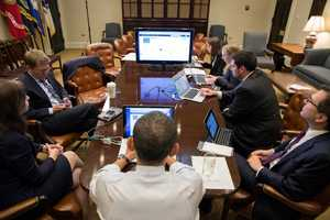 President Barack Obama participates in a live Twitter question and answer session in the Roosevelt Room of the White House, Dec. 3, 2012.