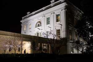 President Barack Obama walks along the Colonnade of the White House, Dec. 12, 2012.