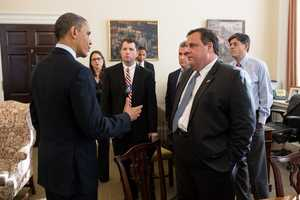 President Barack Obama greets New Jersey Governor Chris Christie and members of his staff in Chief of Staff Jack Lew's office in the West Wing of the White House, Dec. 6, 2012.