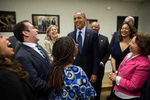 President Barack Obama talks with stage participants after delivering remarks at a My2K event in the Eisenhower Executive Office Building South Court Auditorium, Dec. 31, 2012.