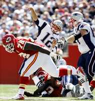 Sept. 7, 2008: New England Patriots quarterback Tom Brady has his leg buckled by Kansas City Chiefs safety Bernard Pollard, bottom, during the first quarter of a football game at Gillette Stadium. The tackle Pollard was legal, though the NFL has since outlawed the type of lunge that hurt Brady.