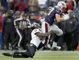 Baltimore Ravens strong safety Bernard Pollard (31) pulls down New England Patriots tight end Rob Gronkowski (87) after a pass reception during the first half of the AFC Championship NFL football game Sunday, Jan. 22, 2012, in Foxborough, Mass. Gronkowski was injured and did not play at 100% in the Super Bowl