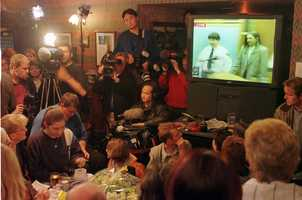 Members of the public in Elton, home of Woodward gather in the local pub The Rigger to watch live coverage of the trial.