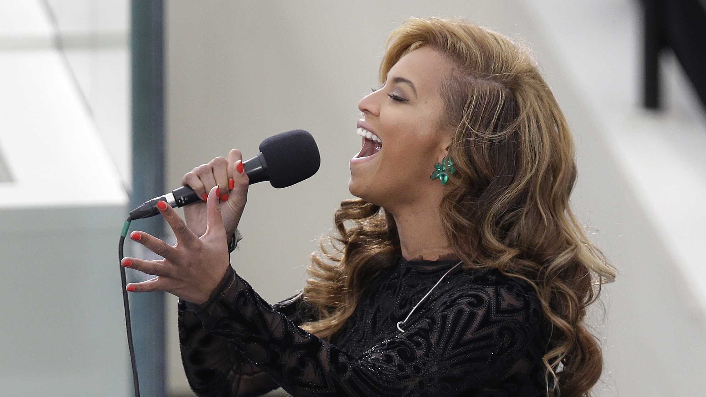 Beyonce sings the National Anthem at the ceremonial swearing-in for President Barack Obama at the U.S. Capitol during the 57th Presidential Inauguration in Washington, Monday, Jan. 21, 2013.