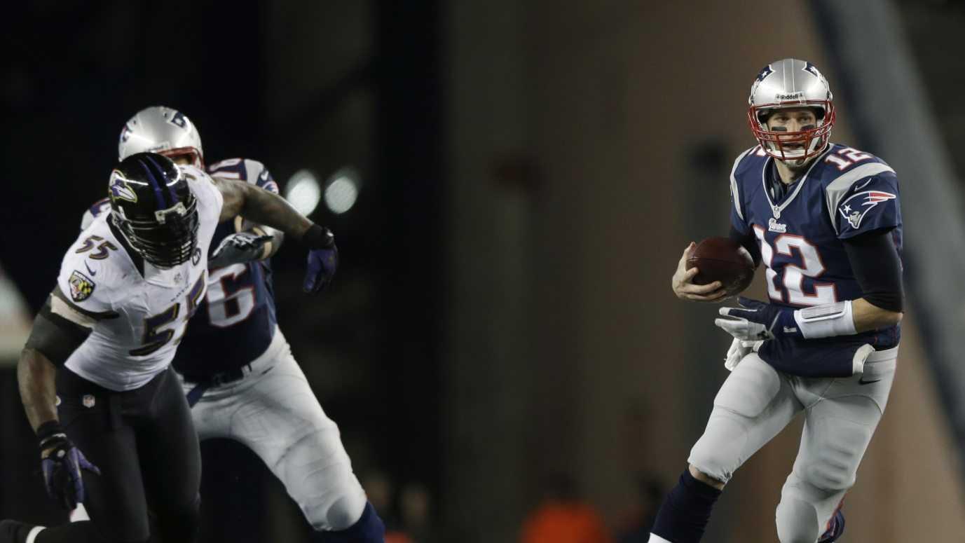Tom Brady Chased by Suggs - AP.jpg