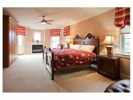 A fireplaced master bedroom suite.