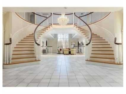 A double stairway greets guests.