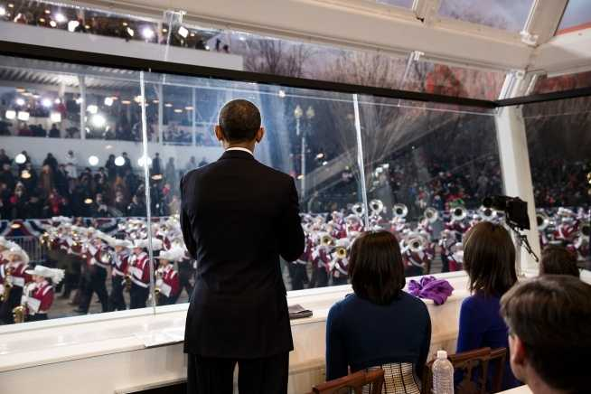 President Barack Obama, First Lady Michelle Obama, and daughters Malia and Sasha watch the inaugural parade from the reviewing stand on Pennsylvania Avenue in Washington, D.C., Jan. 21, 2013.