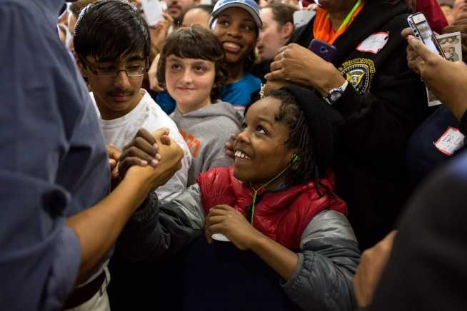 President Barack Obama greets volunteers at Burrville Elementary School in Washington, D.C., Saturday, Jan. 19, 2013.