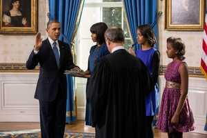 Supreme Court Chief Justice John Roberts administers the oath of office to President Barack Obama during the official swearing-in ceremony in the Blue Room of the White House on Inauguration Day, Sunday, Jan. 20, 2013. First Lady Michelle Obama, holding the Robinson family Bible, and daughters Malia and Sasha stand with the President.