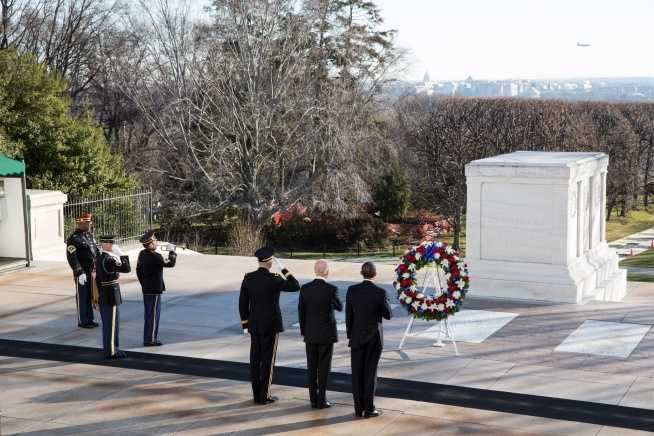 President Barack Obama and Vice President Joe Biden pause during a wreath laying ceremony at the Tomb of the Unknowns at Arlington National Cemetery in Arlington, Va., on Inauguration Day, Sunday, Jan. 20, 2013. Major General Michael S. Linnington, Commanding General of the Military District of Washington, D.C., accompanies them.