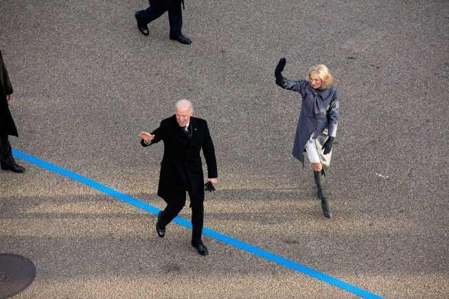Vice President Joe Biden and Dr. Jill Biden walk in the inaugural parade along Pennsylvania Avenue in Washington, D.C., Jan. 21, 2013.