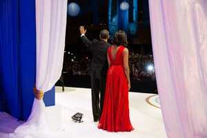 President Barack Obama waves to the crowd with First Lady Michelle Obama during the Inaugural Ball at the Walter E. Washington Convention Center in Washington, D.C., Jan. 21, 2013