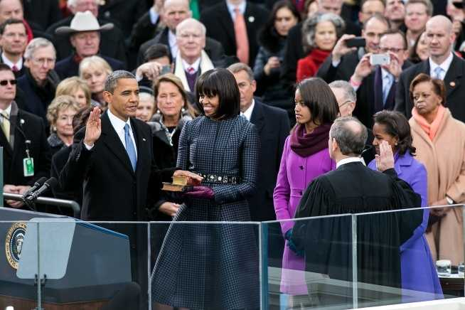 Supreme Court Chief Justice John Roberts administers the oath of office to President Barack Obama during the inaugural swearing-in ceremony at the U.S. Capitol in Washington, D.C., Jan. 21, 2013. First Lady Michelle Obama holds a Bible that belonged to Dr. Martin Luther King Jr., and the Lincoln Bible, which was used at President Obama's 2009 inaugural ceremony. Daughters Sasha and Malia stand with their parents.