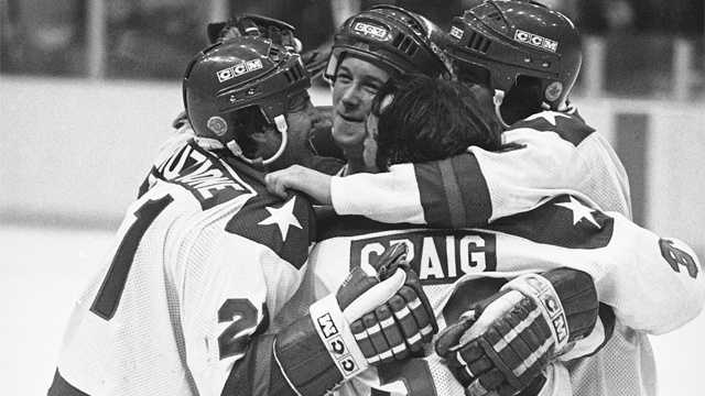 """Miracle on Ice""Michael Eruzione, left, scorer of the decisive fourth goal for the USA in the game against USSR on Feb. 22, 1980 in Lake Placid, is embraced by team mates John O'Callahan, David Silk, and goalie James Craig after he brought his team into the lead. Many on the team attended Boston University."