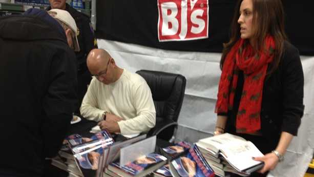 Former Red Sox manager Terry Francona signs copies of his book at BJ's Wholesale Club in Stoughton.