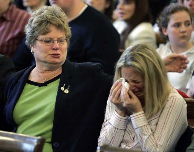 Defendant Dan Biechele's mother, Patricia Biechele, left, and wife, Mandy Gura Biechele, right, react in court, May 10, 2006 in Providence, R.I. after the former tour manager for Great White pleaded guilty to 100 counts of involuntary manslaughter and was sentenced to four years in prison.