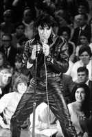 """Elvis Presley was buried in 1977 with a diamond ring set bearing the letters TCB -- """"Take Care of Business."""""""
