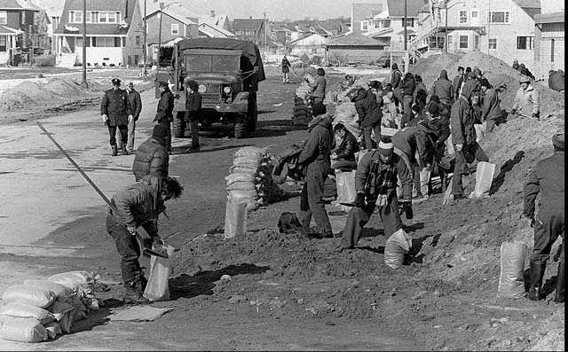 U.S. Army Engineers and Civil Defense volunteers work together filling sand bags in Hull, Mass. in this Feb. 13, 1978 photo in an effort to control flooding after a blizzard hit Massachusetts.