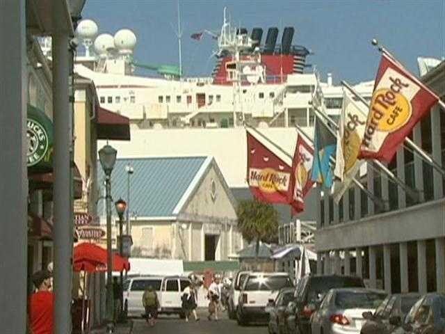 Hordes of visitors shop for high end bargains.