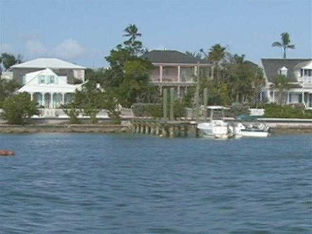 There are colorful, colonial-type cottages on the opposite shore.