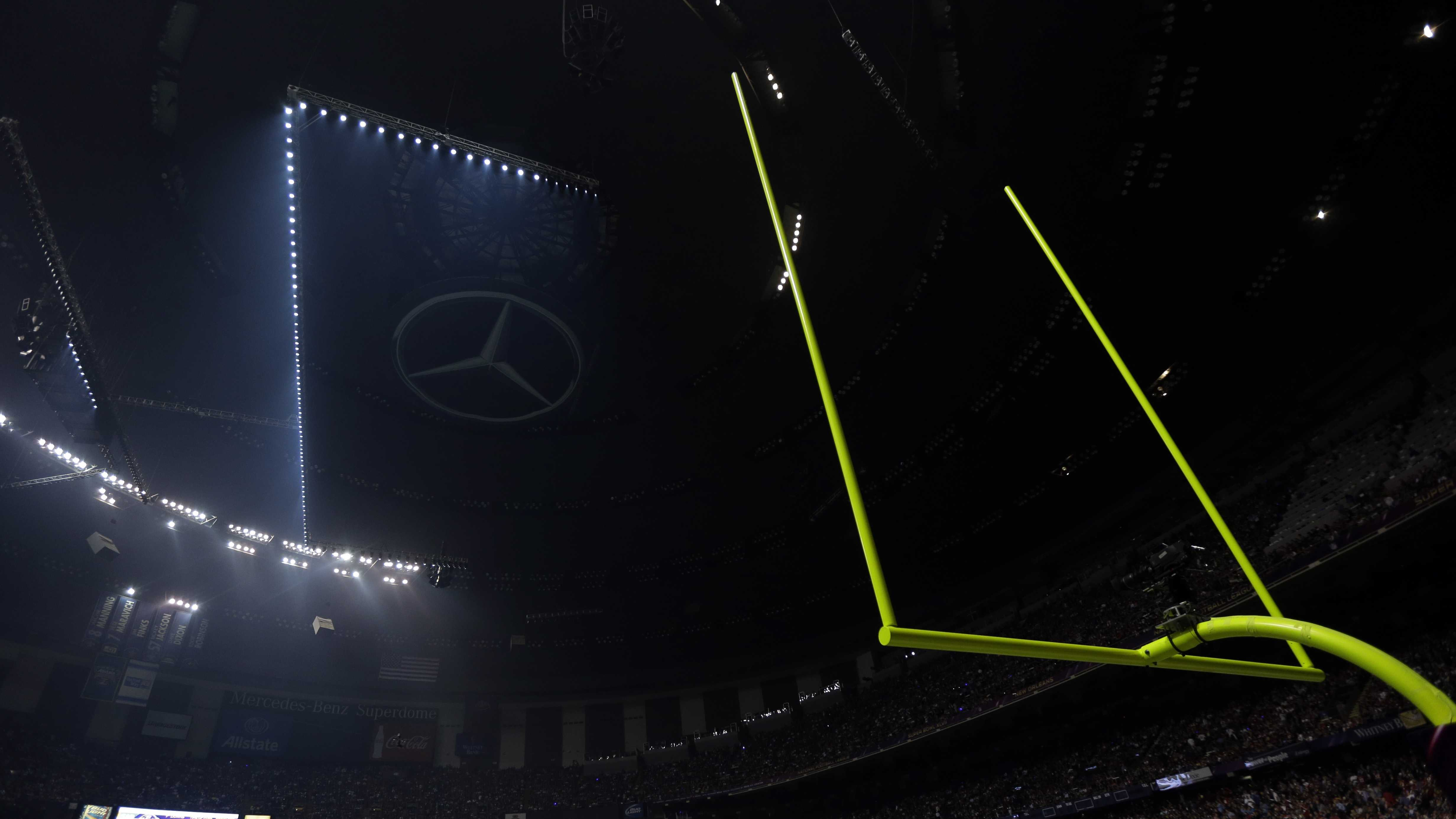 Half the lights are out in the Superdome during a power outage in the second half of the NFL Super Bowl XLVII football game.