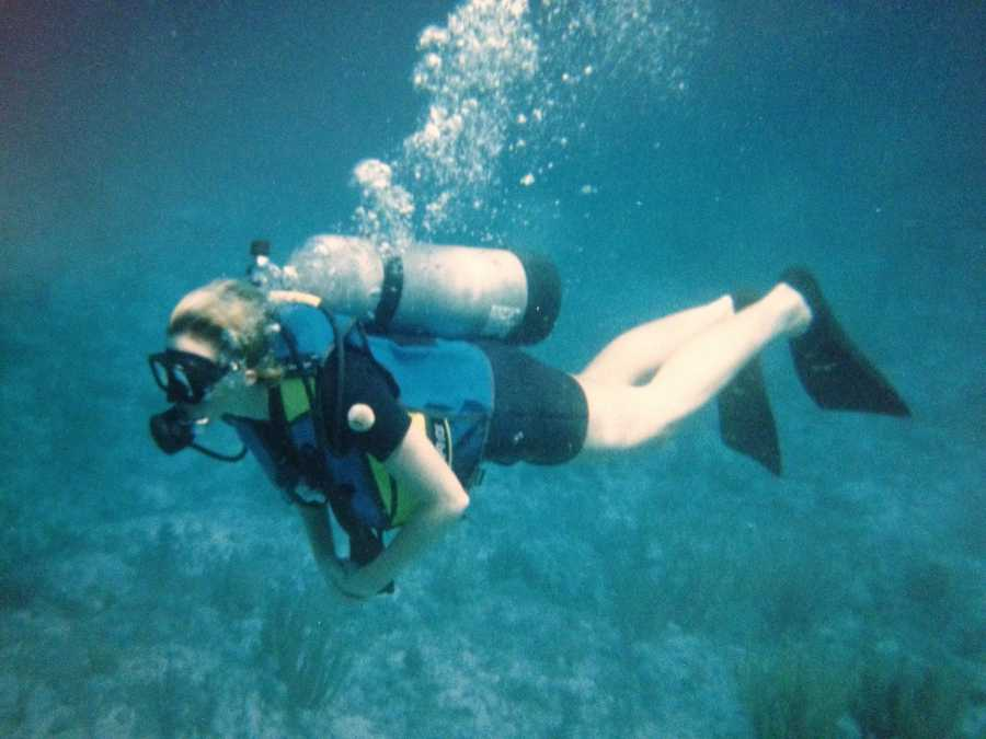 """In the summer, boating and searching for sea glass,"" she says, pictured here scuba diving."