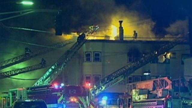 5-alarm fire tears through triple decker
