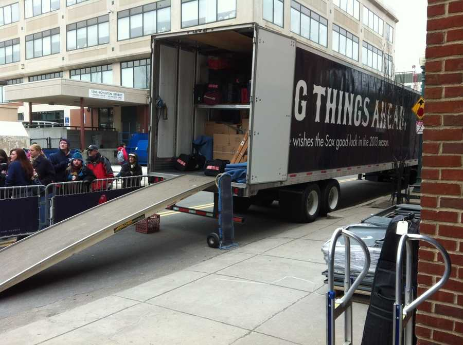 Dozens of die-hard Boston Red Sox fans gathered outside Fenway Park Tuesday, as the team backed up a tractor-trailer bound for spring training in Fort Myers.