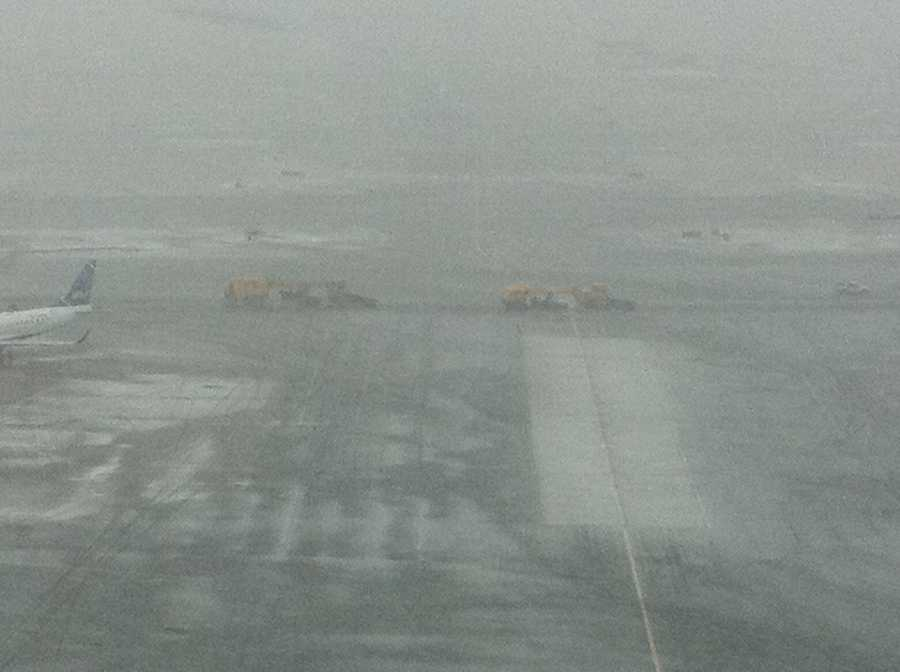 Machines at work on taxiway at Logan.