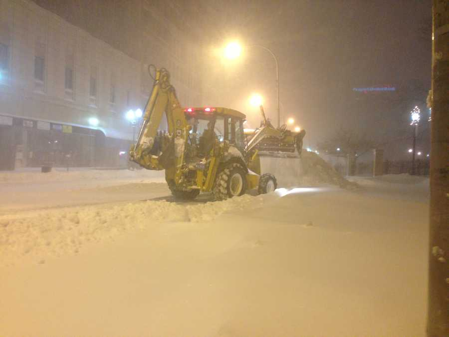Front-end loaders move snow in Worcester.