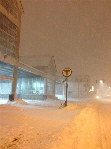A photo of MBTA Andrew Square station on the red line during the blizzard of 2013