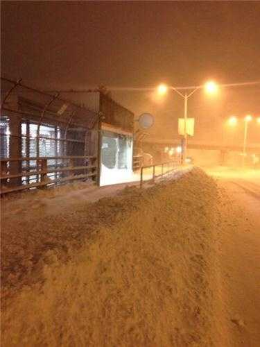 The JFK/UMass MBTA station at the height of the storm.