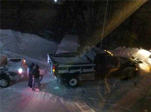 The plow is stuck in the WCVB-TV parking lot, so no one is going home.