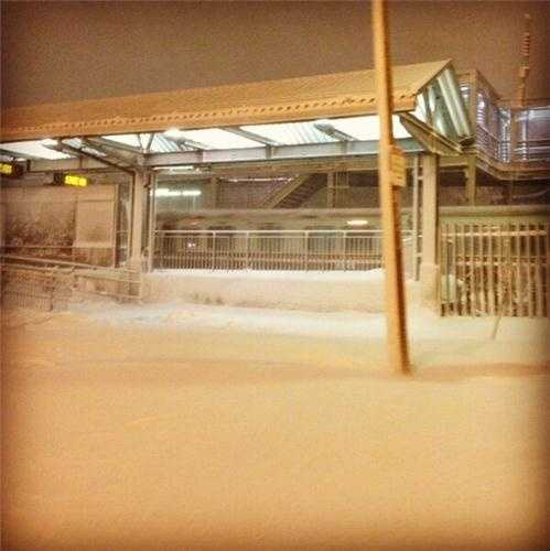 MBTA snow train running through JFK/UMass Station as crews continue to clear snow from tracks