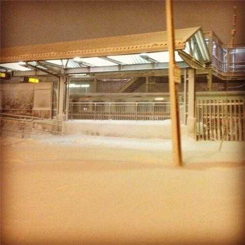 MBTA snow train running through JFK/UMass Station as crews continue to clear snow from tracks