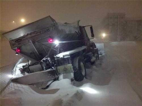 A snow plow stuck in Providence