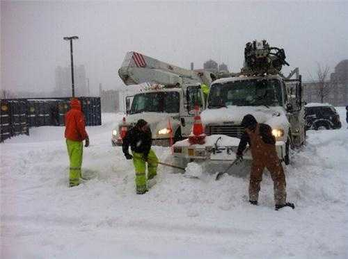 National Grid Workers dig out